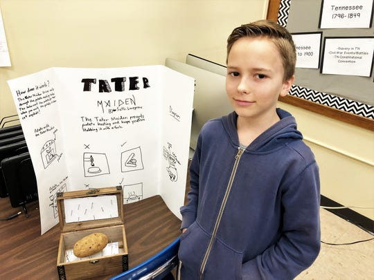 """Seth Lovegrove with his Iron Maiden-inspired invention, """"The Tater Maiden,"""" at Adrian Burnett Elementary School on Feb. 27."""