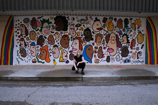 Lafayette native Colette Bernard saw a blank wall on the Children's Museum of Acadiana and wanted to create an inclusive mural. She came up with an I-Spy art piece, one with faces from her sketch book of people watching in New York City, where she goes to school.