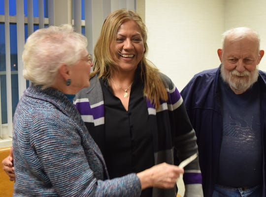 Fairfield County Literacy Council President Janet Warner, left, congratulates Maricruz Delacruz, center, for passing the US citizenship test in November. FCLC volunteer Bernard Paumier, right, worked with Delacruz for nearly two years to prepare for the test. The FCLC paid $400 of the test's $725 total cost.