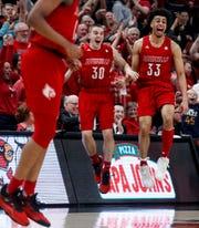 Louisville's Jordan Nwora and Ryan McMahon celebrate teammate Keith Oddo scoring against Virginia Tech on Mar. 1, 2020.