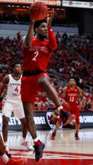 Louisville's Darius Perry drives and dishes against Virginia Tech on Mar. 1, 2020.