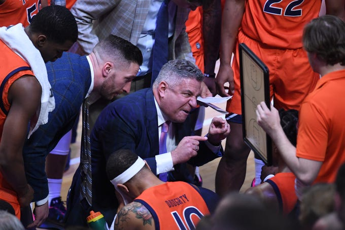 Auburn head coach Bruce Pearl talks to his team during a timeout during the University of Kentucky basketball game against Auburn University at Rupp Arena in Lexington, KY on Saturday, February 29, 2020.