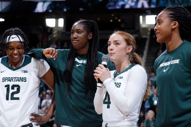 Michigan State's four seniors, Nia Hollie, from left, Victoria Gaines, Taryn McCutcheon and Shay Colley are honored following the game against Penn State, Sunday, March 1, 2020, in East Lansing, Mich.