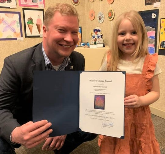 Pictured is Manitowoc Mayor Justin Nickels with Youth Art Month Mayor's Choice Award winner Emerson O'Barski of Jackson Elementary School.
