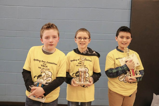 The top three finishers in last Thursday's third-grade spelling bee were, from left, Liam McCumiskey, Spanish Immersion School, second; Mason Morrow, St. Mary of the Snows, third; and Owen Doan, Spanish Immersion, first.