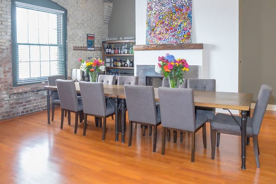 The dining room table, in the open and loft-like space, offers a variety of entertaining options.