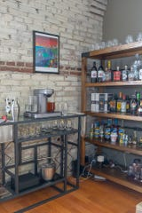 A beverage station beckons in the loft-style condo of Andrea Churchill.