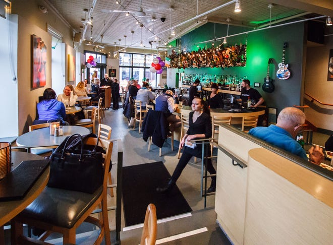 Patrons relax at Taylor's People's Park in Waukesha. The popular restaurant is among the businesses in Waukesha housed inside historic buildings, which can create accessibility problems for people with mobility restrictions.