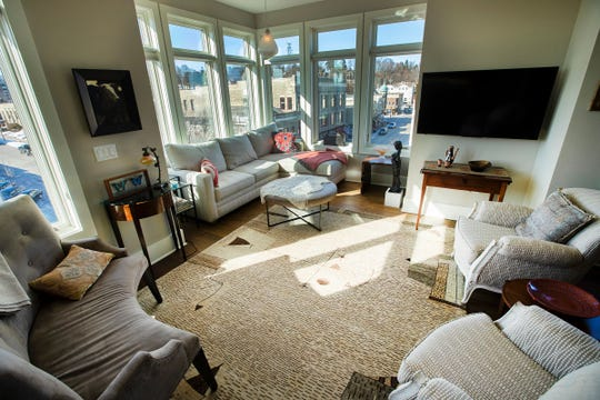 The living room is shown at the condo of C.T. Whitehouse and Barbara Joosse in downtown Port Washington.