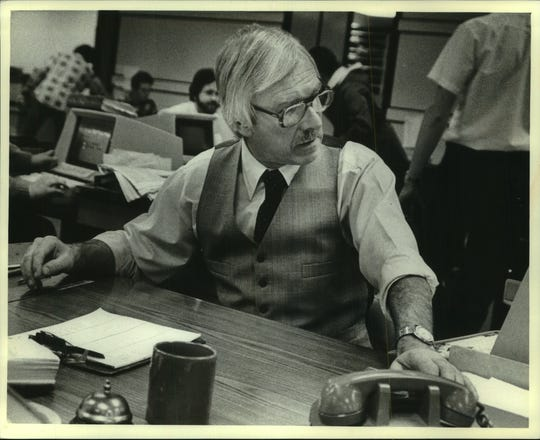 The Milwaukee Journal news editor Howard Fibich is shown in the Journal's newsroom in 1982. Fibich spent 37 years at the afternoon newspaper, rising from the copy editing ranks to retire as deputy managing editor in 1993. He died Feb. 27 at the age of 88.
