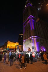 People gather during a vigil at Milwaukee City Hall reflecting on last week's Molson Coors shooting.