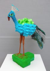 The PeepCock sculpture was the Peeples Choice Award Winner in the 2019 International Peeps art exhibition at the Racine Art Museum.  It was created by Marja and Sydney Stehling.