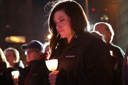 "Katie Leinenkugel, a brand manager for Molson Coors, tears up with emotion as she holds a candle with others during a vigil at Milwaukee City Hall on Sunday reflecting on last week's Molson Coors shooting. The interfaith event, ""Milwaukee Strong: A Vigil to Unite & Heal,"" remembered the victims and included political speakers as well as local clergy and citizens."