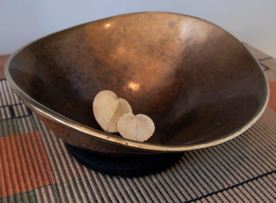 A bowl made by C.T, Whitehouse is shown at the condo he owns with Barbara Joosse in downtown Port Washington.  Joosse bought the bowl from him in 1997 when she met him for the first time at Milwaukee's Lakefront Festival of the Arts.