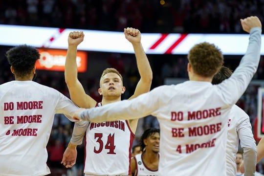 Brad Davison (34) celebrates after Wisconsin defeated Minnesota on Sunday.