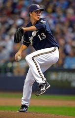 Zack Greinke helped lead the Brewers to the playoffs in 2011.