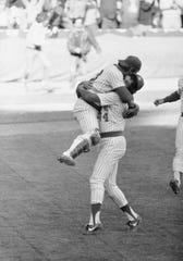 Milwaukee's Rollie Fingers carries catcher Ted Simmons following the Brewers 2-; victory over Detroit to take the American League east on Saturday, Oct. 3, 1981 in Milwaukee. (AP Photo/Pyle) ORG XMIT: APHS176483