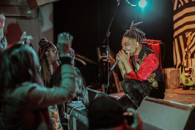 Local rapper Taj Raiden performs at the Cactus Club.