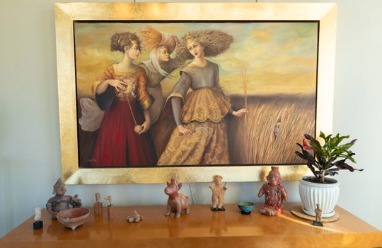 Artwork purchased in Mexico decorates the living room  at the condo of C.T. Whitehouse and Barbara Joosse.