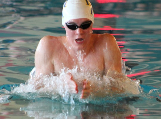 Mountain Home's Hudson Pace competes in the 100-yard breaststroke event he won at the Class 5A State meet on Saturday at Russellville.