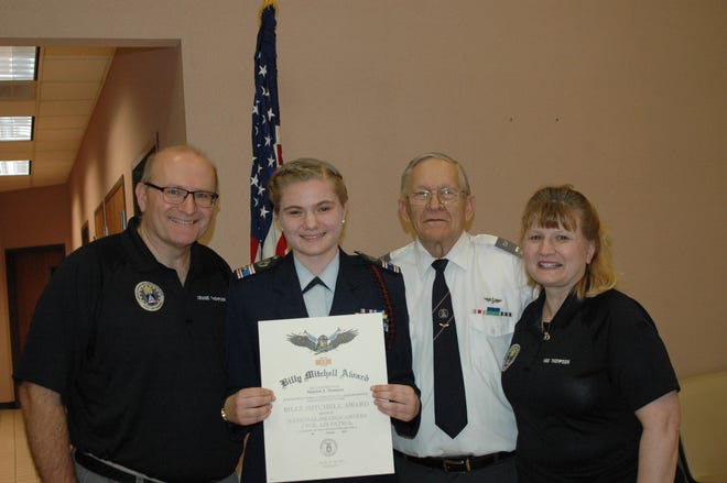 Civil Air Patrol Cadet 2nd Lieutenant Madaline Thompson recently received the Bill Mitchell Award. Shown above are (from left) Craig Thompson, Madaline Thompson, Richard Hatton and Heidi Thompson.