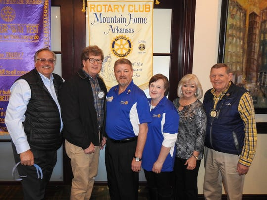 """On Thursday, Feb. 27, the Rotary Club of Mountain Home was honored to have as their guest speaker Kevin Merrill and his wife Lisa from the Harrison Rotary Club. Kevin will become the Governor of District 6110 on July 1, 2021. He and Lisa brought a program to the local club about their recent National Immunization Day (NID), where 2 million volunteers gave 2 drops of the life-saving polio vaccine to over 200 million children under the age of 5 in one day in India. They spoke about the incredible and humbling experience they had with five other volunteers from our four-state district. Merrill also presented Stewart Brunner of the Mountain Home Club with his """"Major Donor"""" credentials and thanked the local club for their generosity toward the Rotary Foundation, which funds the global polio eradication efforts. Merrill said that """"Charity Navigator,"""" who ranks international charities, gave The Rotary Foundation the No. 1 ranking -- tied with three others in the world -- assuring donors that the money they give goes to their intended purpose. Merrill recognized Stewart Brunner, Bruce and Marilyn Loveless, and David Matty for being Major Donors, plus Larry and Brenda Nelson as Level-Three Major Donors to the Rotary Foundation. Pictured above are Major Donors (from left) David Matty, Stewart Brunner, Kevin and Lisa Merrill, and Brenda and Larry Nelson)."""