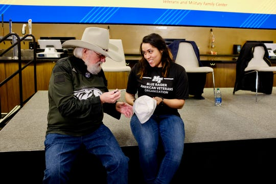 Country Music Hall of Famer Charlie Daniels signs an autograph for MTSU student veteran Teresa Carter on Monday after an announcement at Bridgestone Arena. The Nashville Predators will partner with MTSU to help raise funds for student veterans who have exhausted their federal funds for education or had them expire before earning their degrees. Carter, 27, is a sophomore and served in the U.S. Marine Corps.