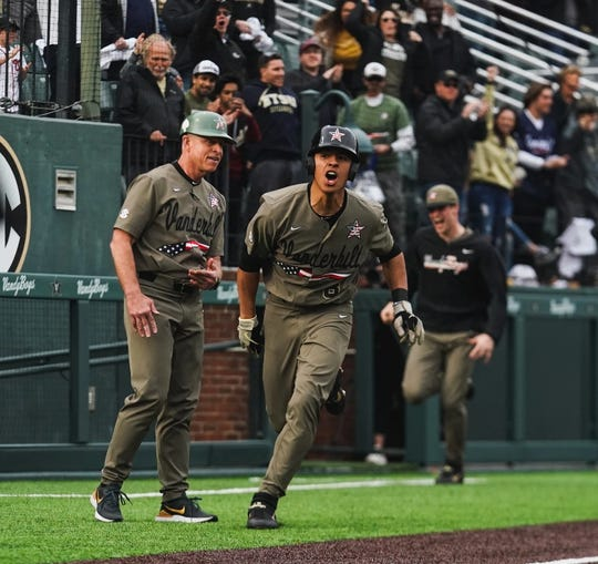 Vanderbilt sophomore Isaiah Thomas, right, celebrates his walk-off home run in the 11th inning to beat Hawaii on Sunday, March 1, 2020, alongside coach Tim Corbin.