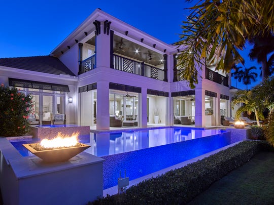 Designed to spend time outdoors year-round, this luxury home features a gourmet summer kitchen and more. Located in Aqualane Shores in Port Royal, Naples, Fla.