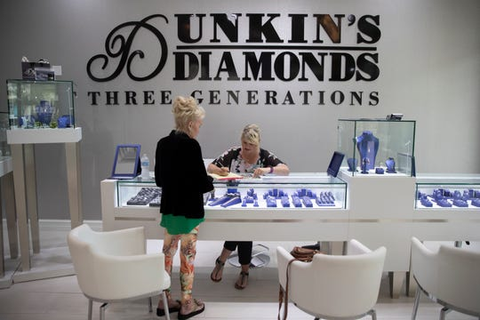 Bobbi Dickson, right, a floor manager for Dunkin' Diamonds obtains details about Nancy Schumacher's lost necklace, Monday, March 2, 2020, at Dunkin's Diamonds in North Naples.