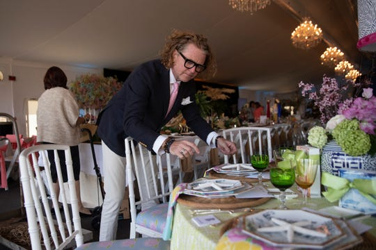 Danny Geschardt with Geschardt Art and Design puts the finishing touches to his table display, Monday, March 2, 2020, at the Ritz Carlton Tiburon Golf Resort.
