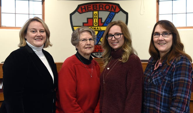 Hebron Village Council members Valerie Mockus,  council president Annelle Porter, Paige Seymour and Andrea Chapman pose before a bi-monthly meeting of the council. Of the six council members four are women.