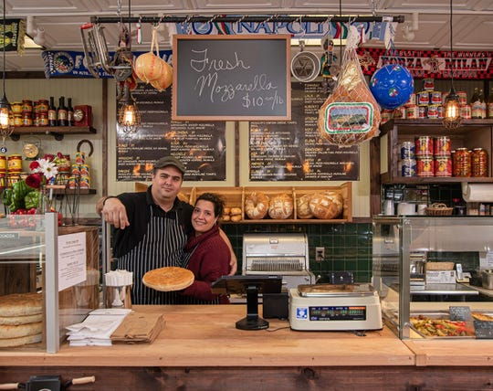 Annamaria Adinolfi and her husband Tim Salouros at their new deli in East Rutherford
