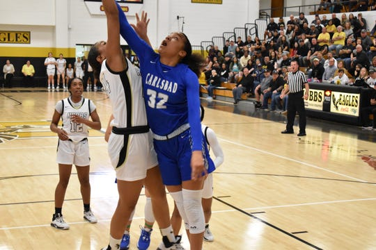 Allie Myers battles for a rebound Saturday night during the Cavegirls' 54-32 loss to Hobbs in Tasker Arena.