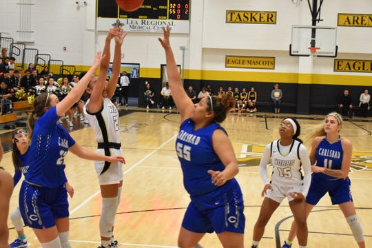Kaliyah Montoya tries to block a shot during the first half of the Cavegirls' 54-32 loss to Hobbs on Saturday in Tasker Arena.