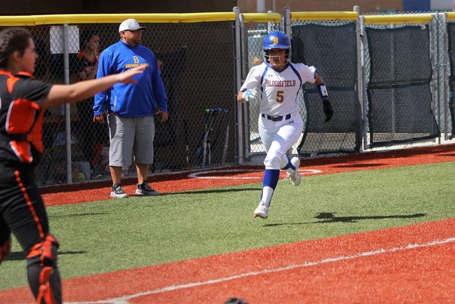Bloomfield's Tina Reza darts to home plate and scores a run against Taos on Saturday, March 23, 2019, at Bloomfield Softball Complex. The Lady Bobcats will host Piedra Vista on March 7.