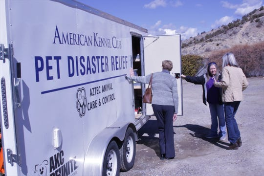 Aztec Animal Shelter Director Tina Roper, center, shows Barbara Schwartz, left, and Jan Owen, right, the new pet disaster relief trailer, Monday, March 2, 2020, in Aztec.