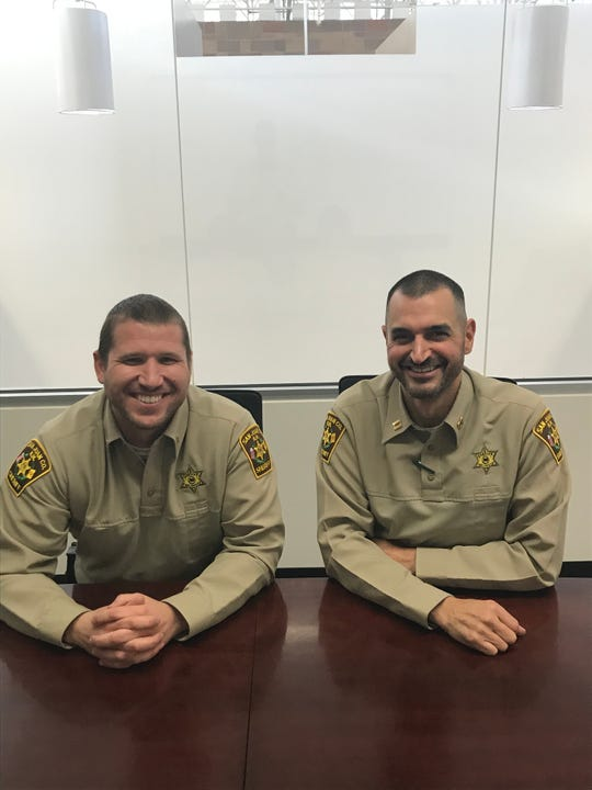 Jarrod Slindee and Mark Pfetzer of the San Juan County Sheriff's Office, seen in uniform, are preparing for the race of a lifetime, competitive rowing across the Atlantic Ocean. The cause: Bringing attention to the number of first responders lost to suicide.