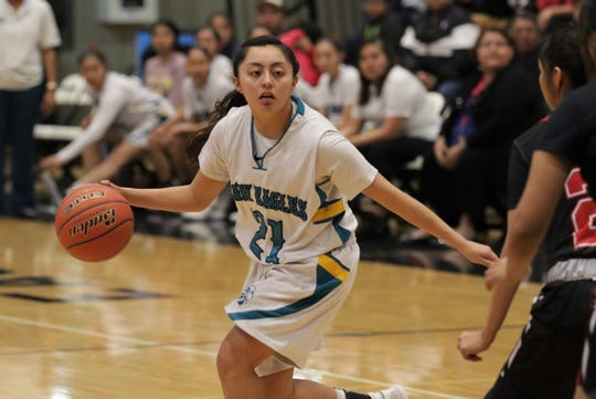 Navajo Prep's Holly Walker moves the ball against Crownpoint during a District 1-3A girls basketball tournament semifinals game on Wednesday, February 26, 2020, at the Eagles Nest in Farmington.