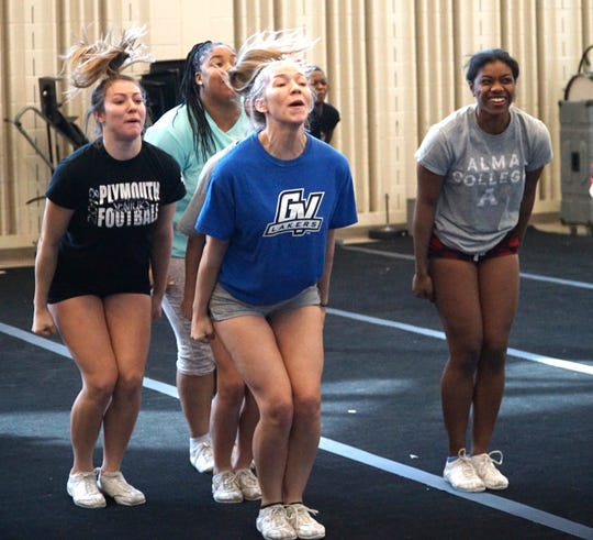 The Plymouth High School competitive cheer team practices on March 2, 2020 at the school as they get ready for state finals.