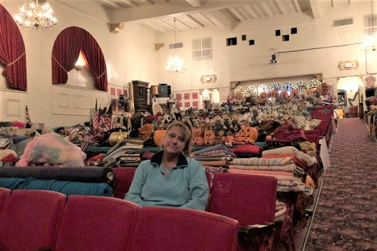Christina Zayti sits in the Marquis Theatre surrounded by props and other items that have graced the 96-year-old entertainment hub.