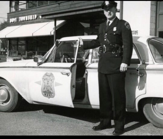LeeBeGole, the first police chief of Novi, with his car on patrol when Novi was still a township.