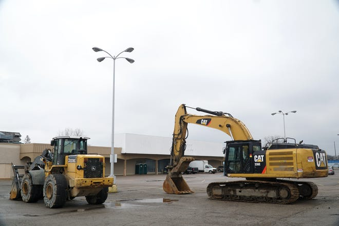 A bulldozer and backhoe get ready to tear down the former Kmart building on Ford Road in Garden City.