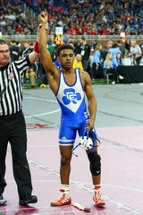 Josh Edmond celebrates his second individual state title at Ford Field.