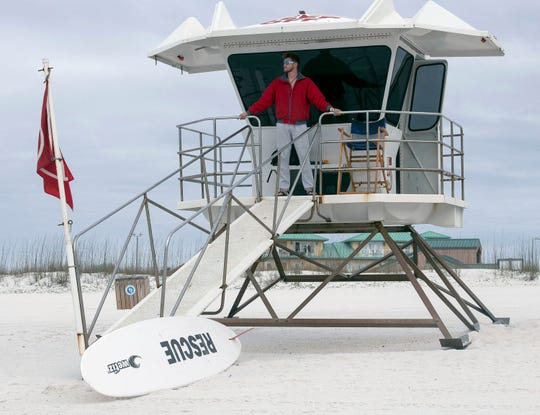 Pensacola Beach lifeguard Justin Pate staff tower No. 5 during his shift at Casino Beach on Monday.
