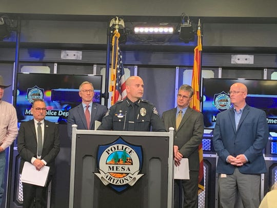 Ken Cost speaks after being named Mesa police chief on March 2. Behind him is the City Manager, Mayor and City Council.