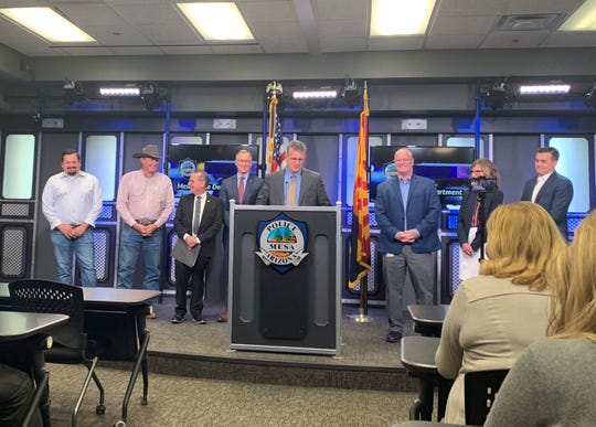 City Manager Chris Brady announces Ken Cost as Mesa police chief on March 2. To his sides are the Mayor and City Council.