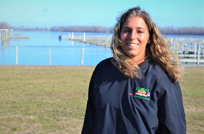 Operating Partner Margaux Gibbs stands outside Cleats Club Seat Grille on the shore of Lake Erie. Cleats is hosting a yearlong fundraiser in honor of employee Joseph Eberle who died unexpectedly in January.