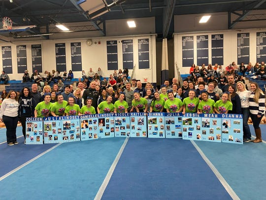 The John Jay High School cheerleading team poses during a celebration of its 12 seniors after a Jan. 19 meet.