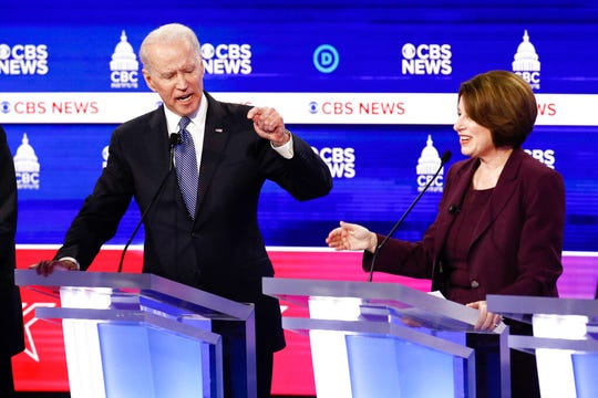 FILE - In this Feb. 25, 2020, file photo Democratic presidential candidates, former Vice President Joe Biden, left, and Sen. Amy Klobuchar, D-Minn., participate in a Democratic presidential primary debate at the Gaillard Center in Charleston, S.C., co-hosted by CBS News and the Congressional Black Caucus Institute. Klobuchar ended her Democratic presidential campaign on Monday, March 2, and endorsed rival Biden in an effort to unify moderate voters behind the former vice president's White House bid. (AP Photo/Patrick Semansky, File)